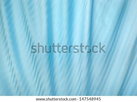 elegant satin silky sheets blue background  - stock photo