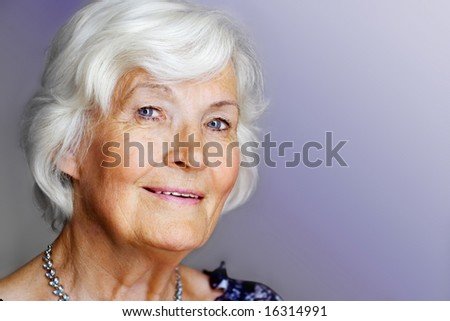 Elegant senior lady portrait with necklace - stock photo