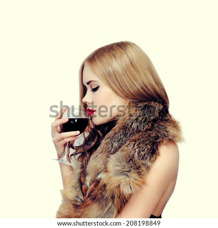 Elegant sensual woman enjoy the taste of wine, vintage colors - stock photo