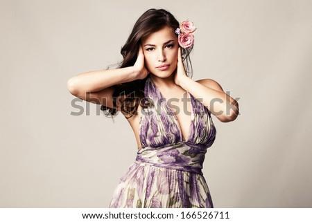 elegant sensual woman  with roses in hair studio shot - stock photo