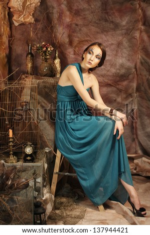 elegant sensual young woman in blue dress
