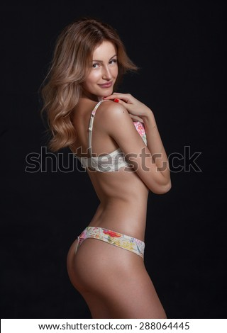 Elegant sexy blonde woman posing in lingerie. Studio shot. Great ass. Very hot. - stock photo
