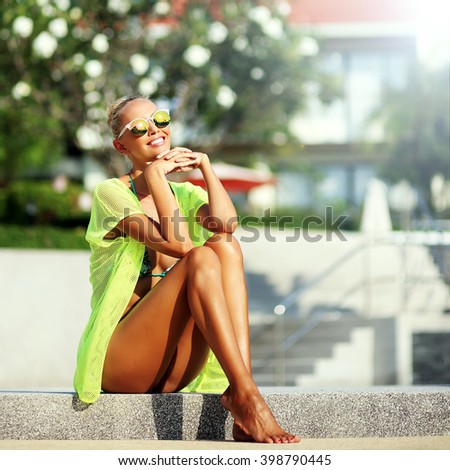 Elegant sexy woman in bikini with tanned slim body posing outdoor - stock photo