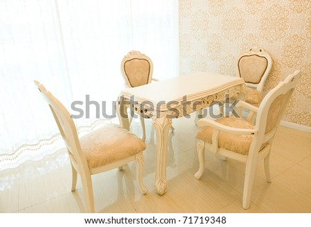 Elegant simple table and chairs in the dining room - stock photo