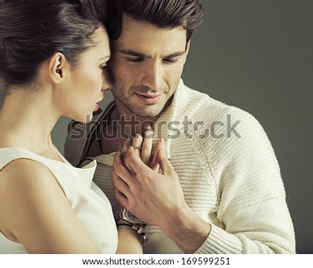 Elegant smiling couple - stock photo