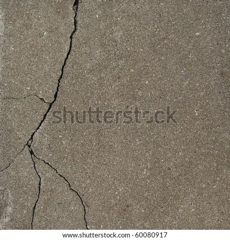 elegant split crack in gray stone surface  with pores - stock photo