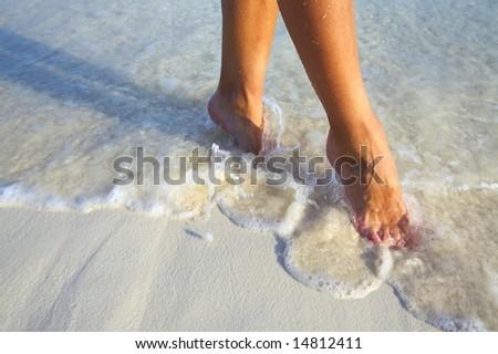 elegant step on a sandy beach - stock photo