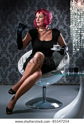 elegant stunning woman with read hair drinking coffee - stock photo