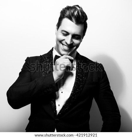 Elegant stylish handsome man. Black-white studio fashion portrait.  - stock photo