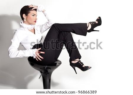 elegant stylish women sitting wearing black and white - stock photo