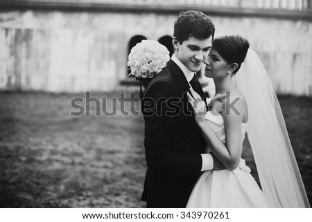 elegant stylish young couple beautiful bride and groom embracing