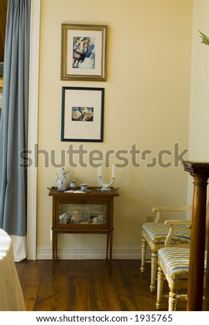 Elegant sunlit traditional living room - stock photo