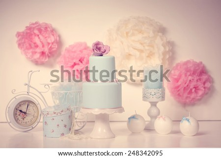 Elegant sweet table with big cake - stock photo