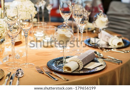 Elegant table set in soft creme for wedding or event party - stock photo