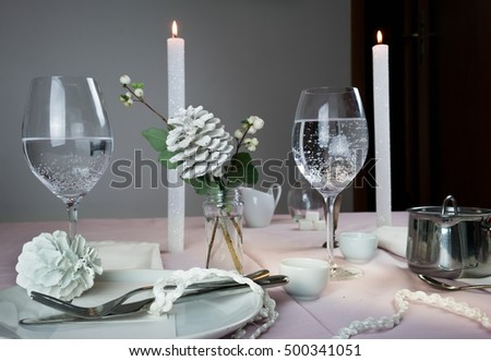 elegant table setting. Christmas. romantic dinner - tablecloth, cutlery, candles, flowers, buds.