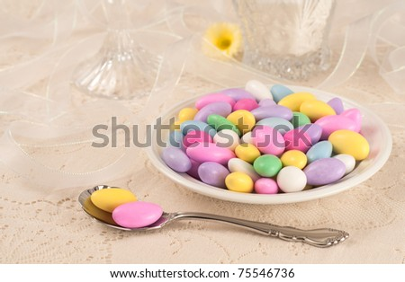 Elegant Table Setting for a Party with Jordan Almonds in Dish with Copyspace or Room for your text or words - stock photo