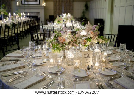 elegant table setting for wedding reception with bouquets - stock photo