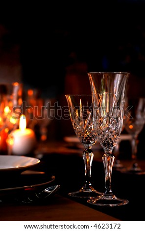 Elegant table setting with champagne glasses and candles - stock photo
