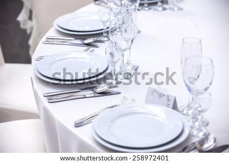 Elegant tables set up for a wedding banquet - stock photo