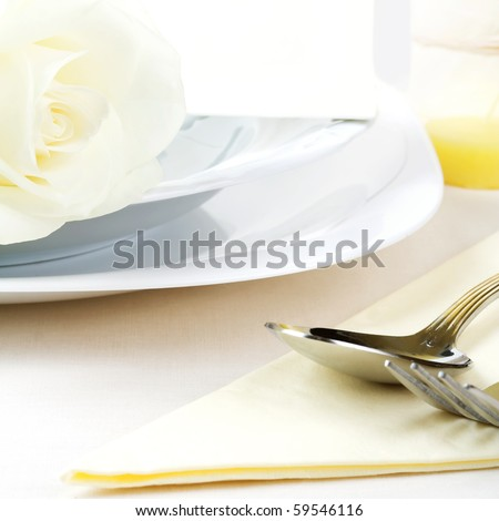 Elegant tableware with rose and invitation. - stock photo