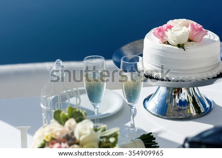 Elegant tasty and delicious white wedding cake with rose flowers closeup - stock photo