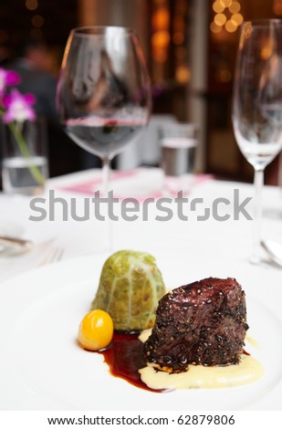 Elegant tenderloin steak on restaurant table - stock photo
