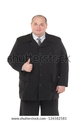 Elegant very fat man in a black suit shows thumb-up, on white background - stock photo