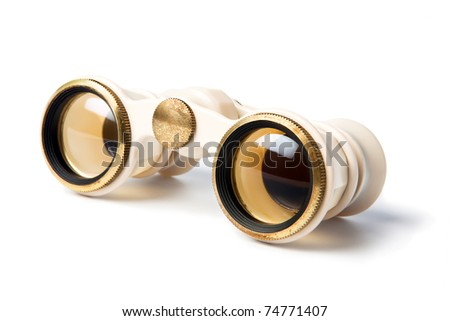 Elegant vintage small theater binocular, decorated with ivory imitation and golden details, isolated on white background - stock photo