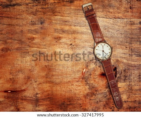 elegant watch closeup on table - stock photo