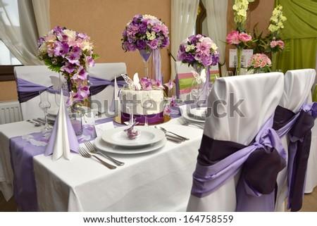 Elegant wedding decoration in restaurant - stock photo
