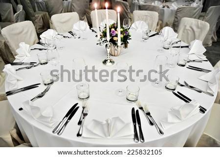 Elegant wedding dinner table arrangement in a restaurant - stock photo