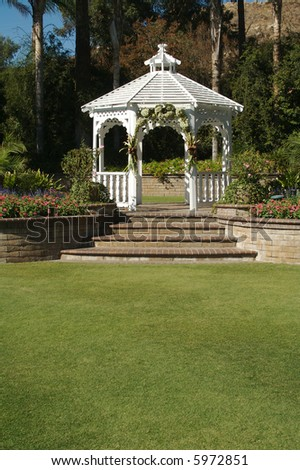Elegant Wedding Gazebo with Steps and Lush Grass. - stock photo