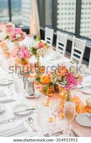 Elegant Wedding Reception table decor and centerpieces - stock photo