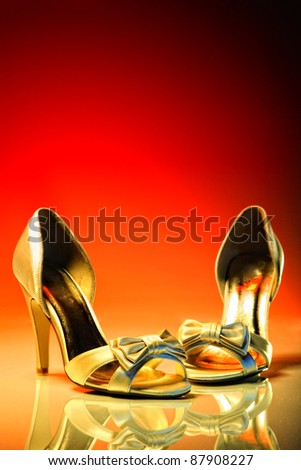 Elegant wedding shoes over red and yellow background