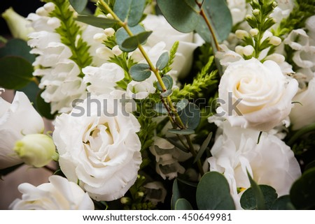 Elegant white bouquet of flowers and leaves macro closeup