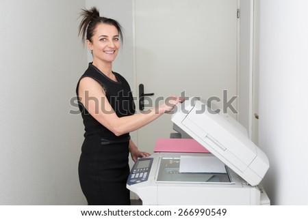 Elegant woman and copy machine  - stock photo