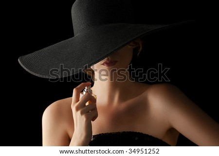 elegant woman applying perfume on her body - stock photo