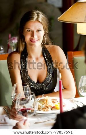 Elegant woman at the restaurant - stock photo