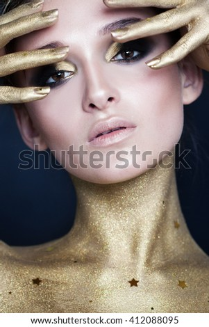 Elegant Woman. Creative Makeup with Gold Stars - stock photo