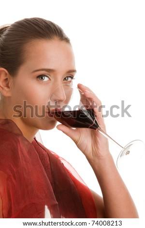 Elegant woman drinking wine - stock photo