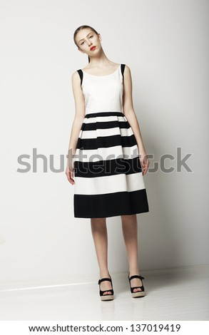 Elegant Woman Fashion Model in Light Striped Cotton Sundress. Vogue Style