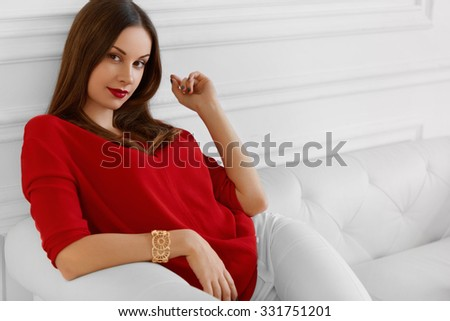 Elegant Woman. Fashionable Beautiful Successful Business Lady Relaxing On Stylish Sofa. Wellbeing, Luxury Lifestyle. Interior, Furniture. - stock photo