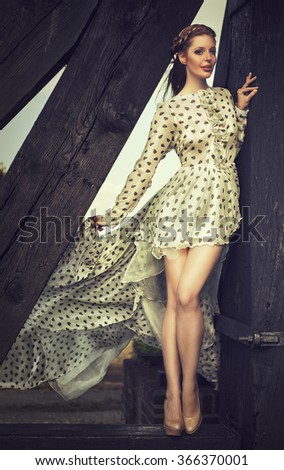 elegant woman in a blowing dress - stock photo