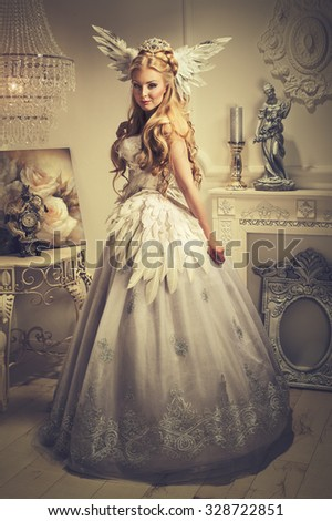 elegant woman in a dress of feathers - stock photo