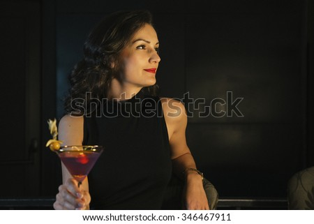 Elegant Woman In a Night Club Drink Cocktail - stock photo