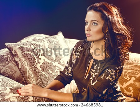 Elegant woman in a stylish interior - stock photo