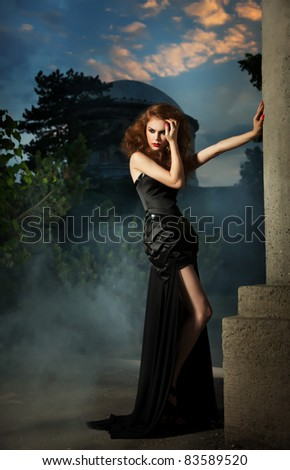 Elegant woman in black dress - stock photo