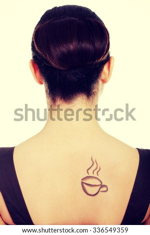 Elegant woman in dress with coffee symbol on her back. - stock photo