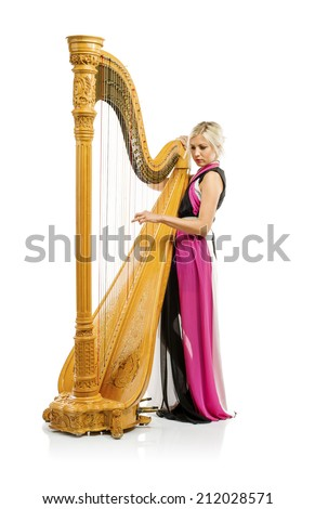 Elegant woman in purple dress playing the harp, isolated on white background