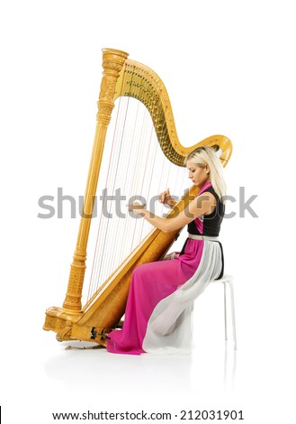 Elegant woman in purple dress playing the harp, isolated on white background - stock photo